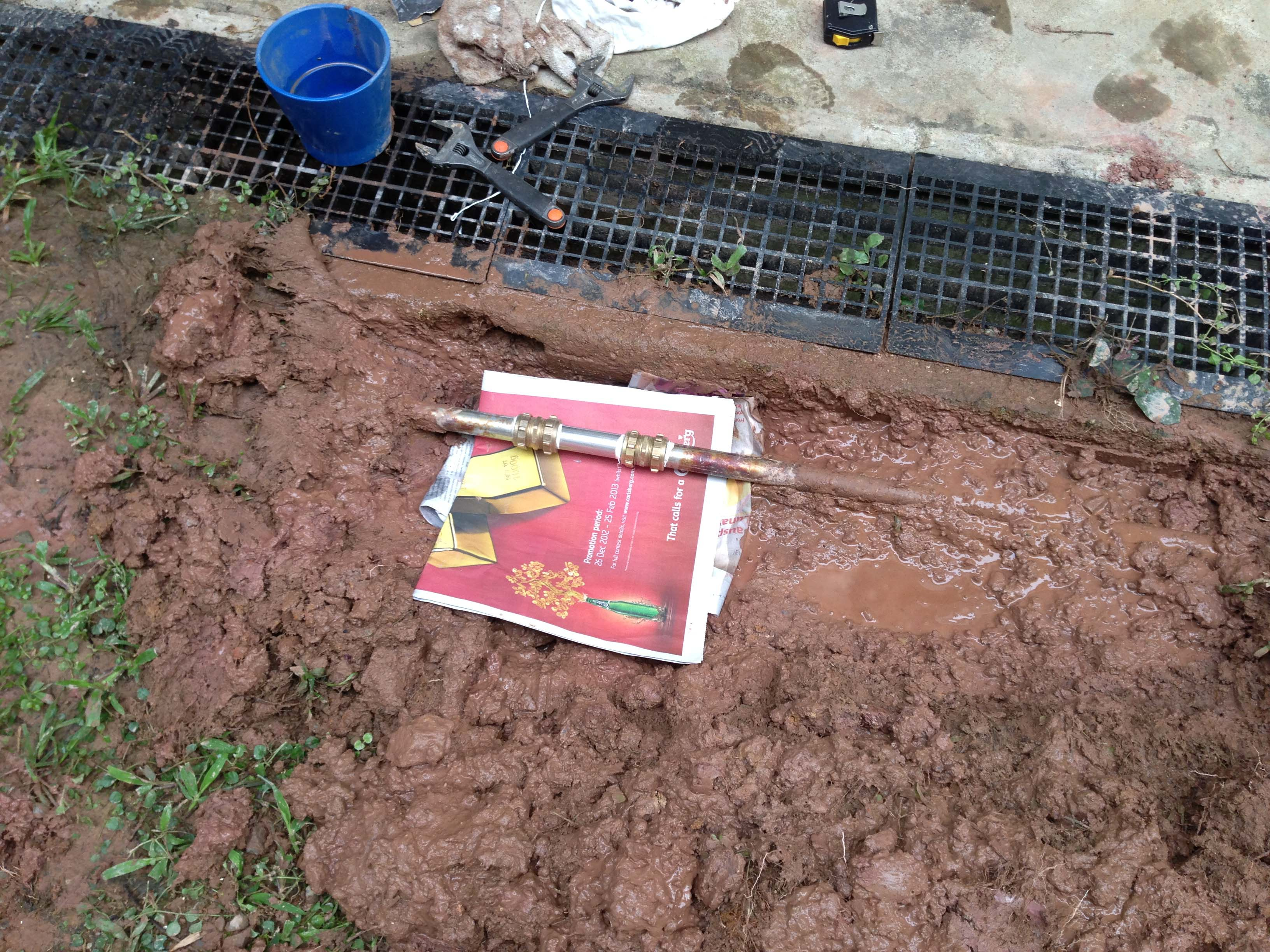 37. under ground pipe leak.  root damage pipe and flooding in garden..jpg